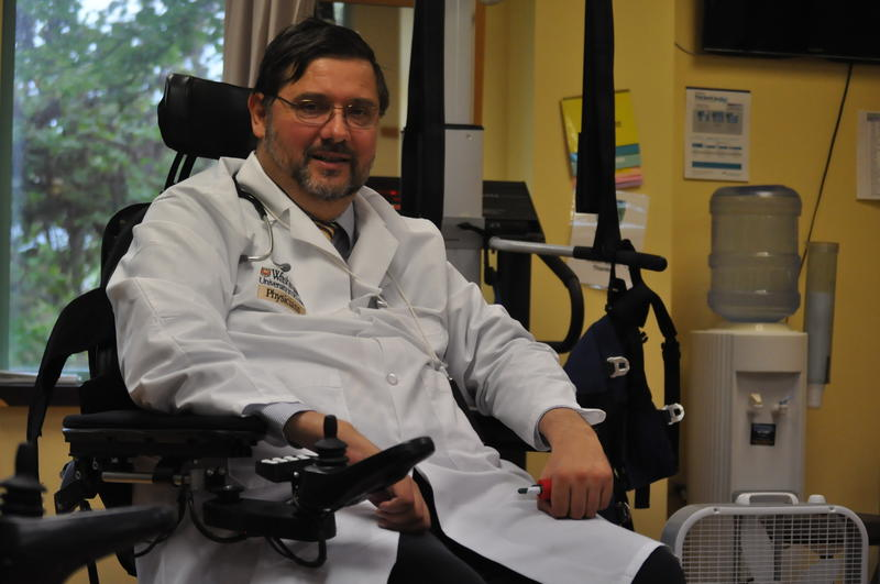 Dr. Michael Bavlsik works as medical director at Barnes Jewish Extended Care in Clayton. He received a nerve-transfer surgery after a spinal cord injury, and has since been able to improve function in his arms, wrists and hands.