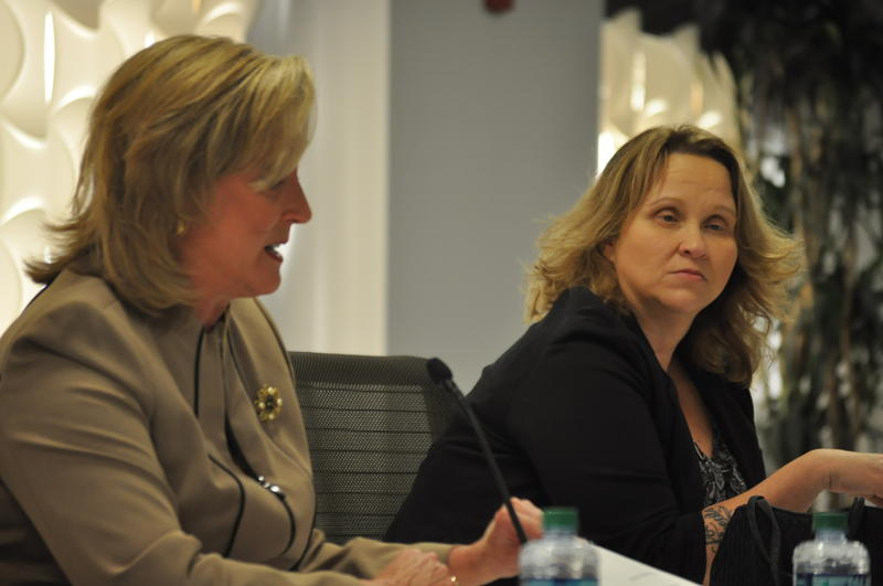 Advocate and author Christine McDonald, right, listens to U.S. Rep. Ann Wagner of Missouri testify during a public hearing in St. Louis about human trafficking.