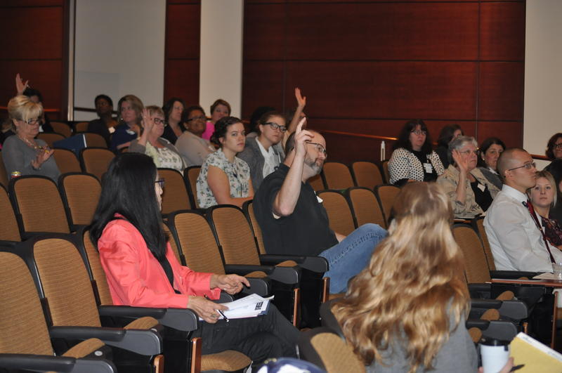 Medical professionals raise hands during a room-wide survey of whether they have provided care to someone they knew or believed was a victim of human trafficking.