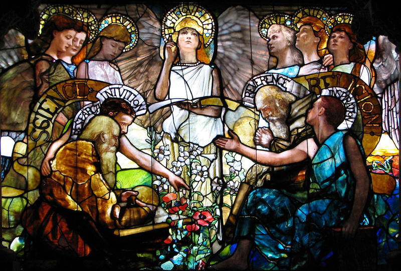 "Dr. Ed Hogan of the St. Louis Archdiocese said he believes there is a ""false"" contradiction between faith-based and scientific beliefs, a theme similarly depicted in this Tiffany stained glass window located at Yale University."