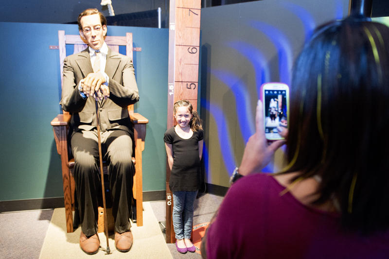 A visitor poses with Robert Wadlow at Saint Louis Science Center