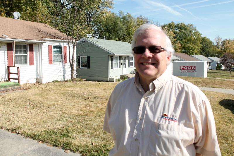 Landlord Jerry Hopping stands in front of one-story houses in Glasgow Village. Hopping has been a major opponent of a bill requiring rental property owners to get licenses.