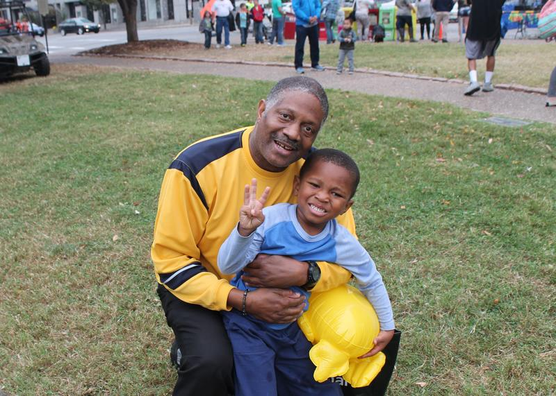 Gary Dorsey of East St. Louis brought his grandson Gregory to the festival; Gregory shows off how old he is.