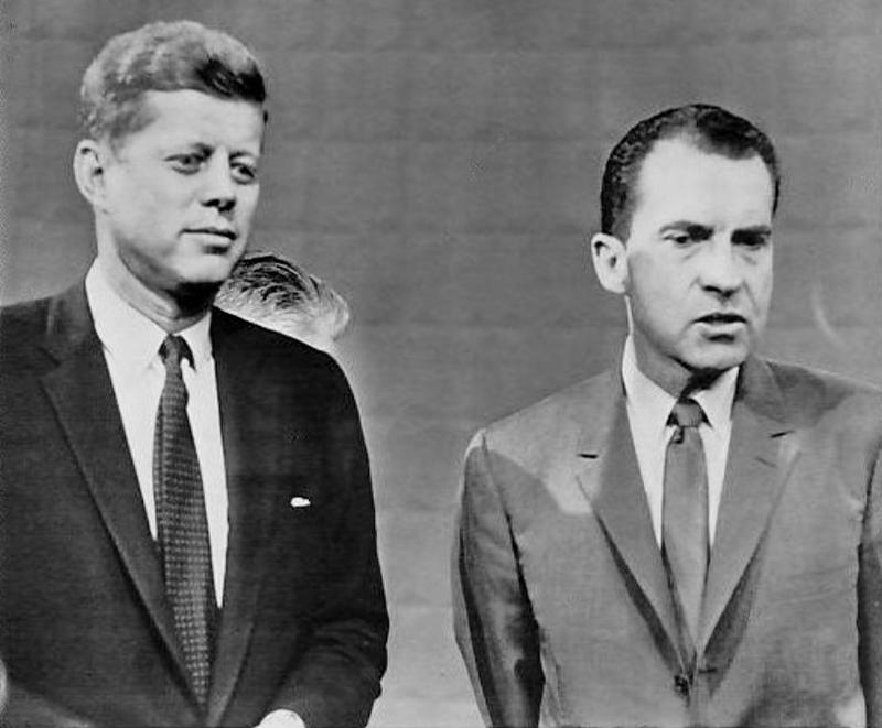 Candidates John F. Kennedy and Richard Nixon pose following their 1960 presidential debate.