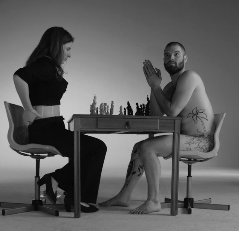 Naked Chess by Jennifer Shahade references a 1963 photograph of artist/chess player Marcel Duchamp playing against a nude woman.