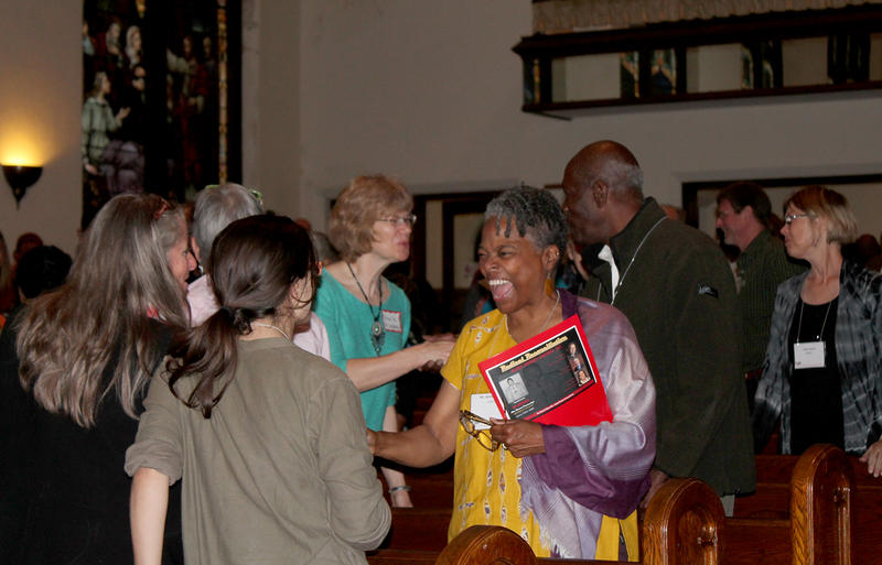 Conference-goers encourage each other to push for the implementation of Ferguson Commission recommendations Saturday Oct. 31, 2015 at St. John's Church.