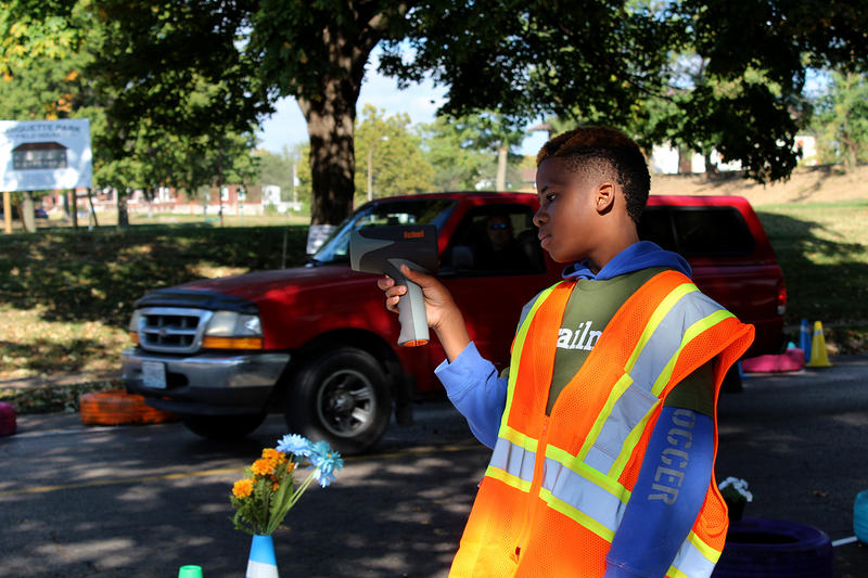 Davion Thompson, 14, clocks the speed of cars passing the intersection of Gasconade Street and Compton Avenue Saturday, Oct 10, 2015 during Trailnet's traffic calming demo.
