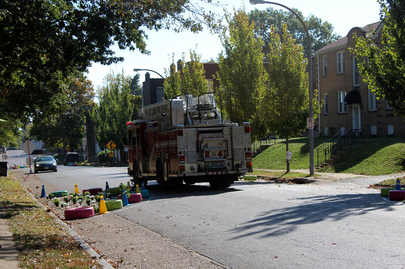 A firet truck from the St. Louis Fire Department tests Trialnet's traffic calming setup to see if its navigable in an emergency Saturday, Oct. 20, 2015.
