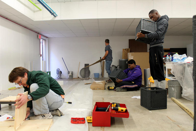 Volunteers put furnishings together for the Ferguson Youth Initiative space behind city hall Oct. 17, 2015.