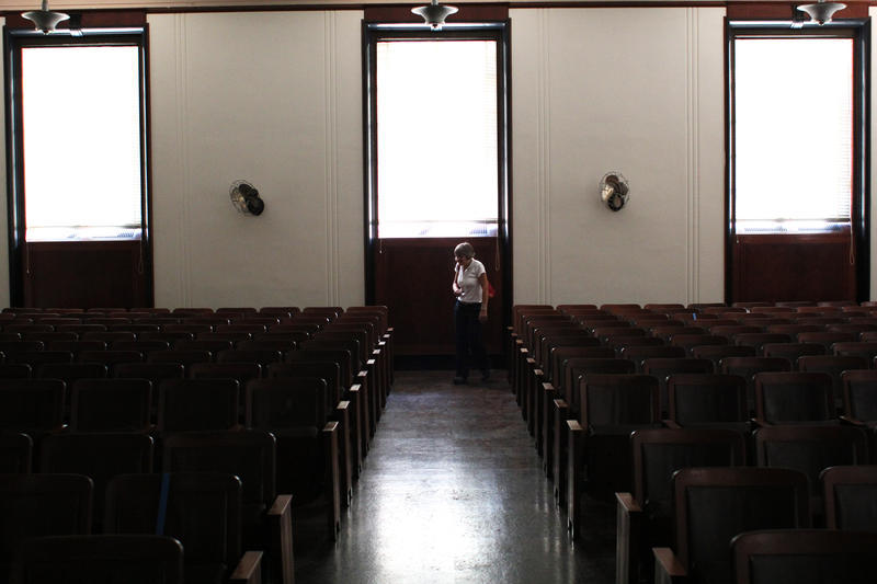 Superintendent Lynnea Magnuson stands in an upstairs meeting room originally only available to men's 'war councils.'