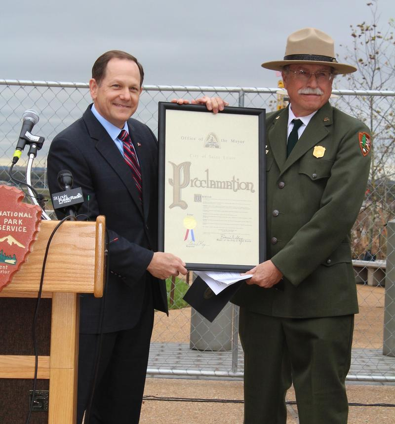 St. Louis Mayor Francis Slay presents a proclamation to Tom Bradley, superintendent of the Jefferson National Expansion Memorial.