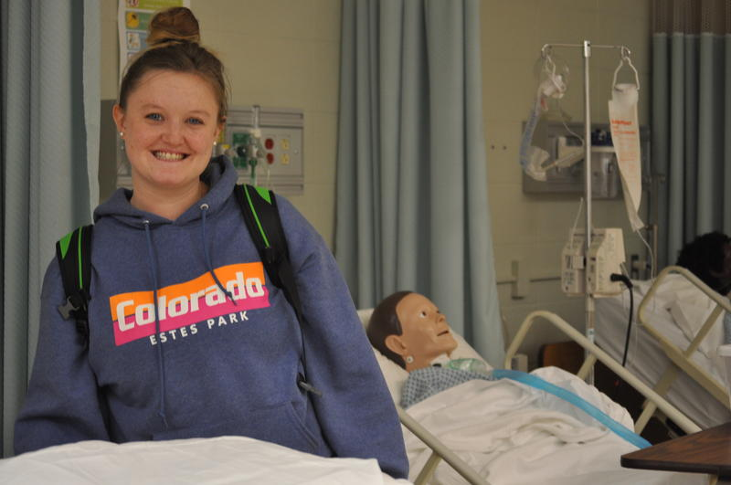 Katie Dorr, 29-year-old a second-year nursing student, pays $125 a month for the least expensive health insurance she could find. Enrollment is required for her to continue her studies.