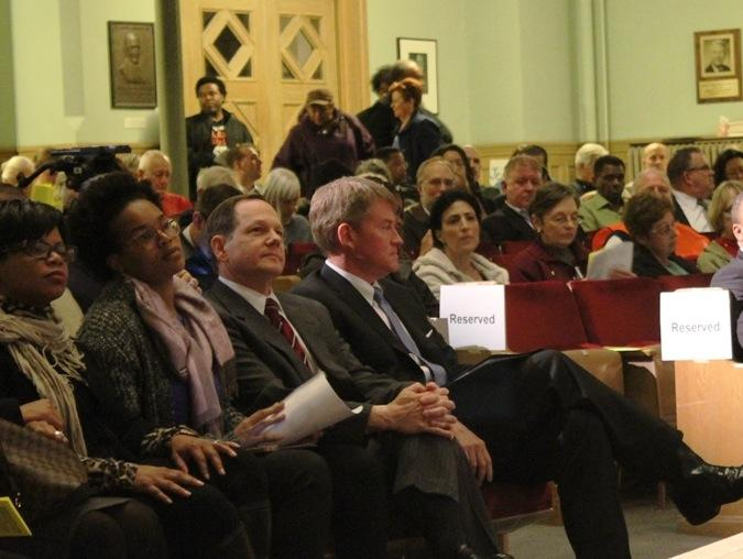 Mayor Francis Slay and attorney general Chris Koster listen to speakers at a second accountability meeting for politicians on Nov 23.