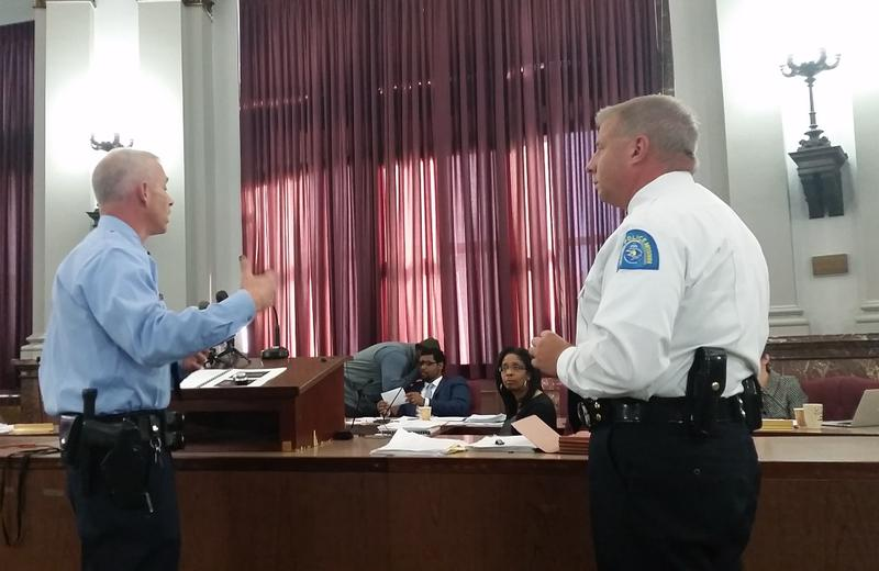 Officer Phil Green, an instructor in the St. Louis Police Academy and chief Sam Dotson present to the subcommittee on police use of force on Nov. 19, 2015.
