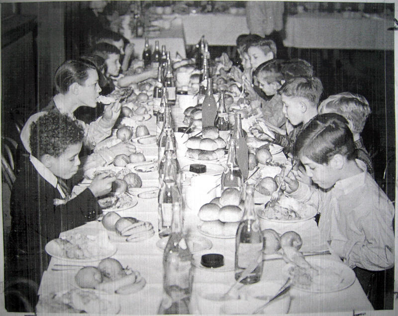 Father Dunne's Newsboys enjoy a Thanksgiving dinner from a mysterious benefactor.