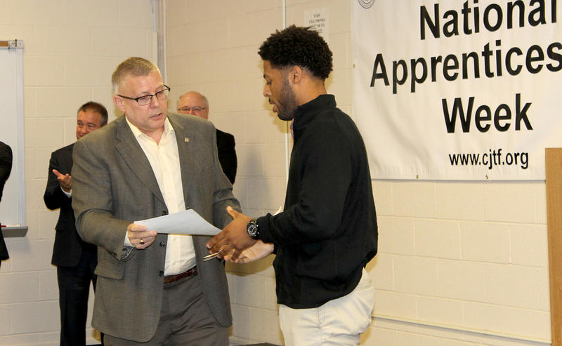 John Gaal, director of training for the Carpenter's Regional Council, gives Charles McElroy a certificate for completing the BUD pre-apprenticeship program on Wed. Nov. 4, 2015.
