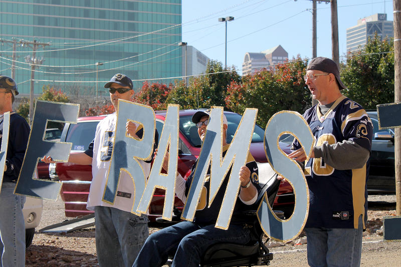 Rams fans line up with letters made by Jill Bauer of Columbia, Ill. on Sat. Nov. 14, 2015.