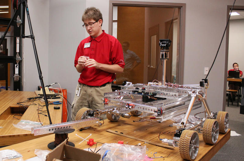 John Stegeman, 18, helped design and build a Mars rover-style robot for the Science Centerexhibit