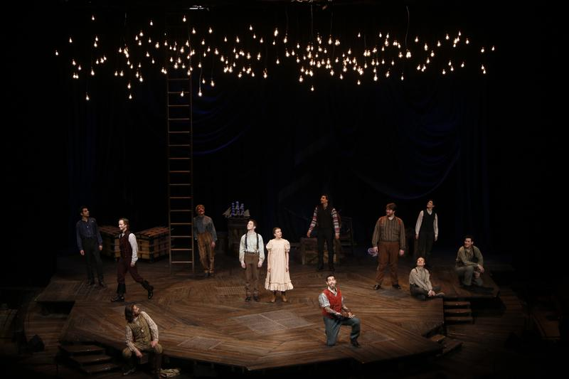 """Peter and the Starcatcher"" ensemble under starlight."