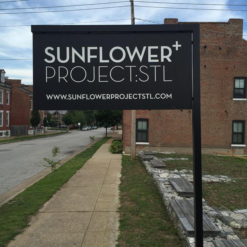 A sign for the Sunflower+ Project in Old North