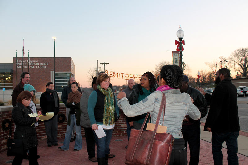 Organization for Black Struggle members organize activists and Ferguson residents into a group outside the Ferguson Police Department Thurs Dec. 3, 2015 to call for public input in the city's consent decree.