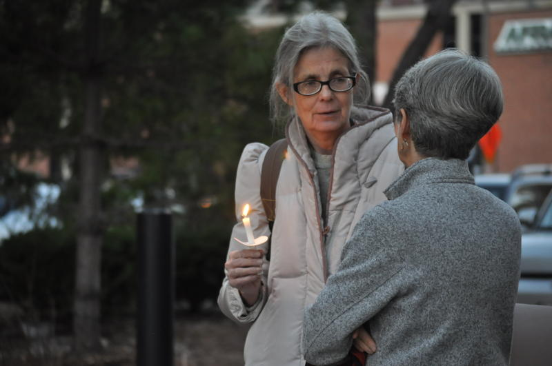Connie Lamka holds a candle during a vigil for nine St. Lousians who died while homeless in 2015. Lamka is a case worker for the New Life Evangelistic Center, and knew two women who passed away this year.