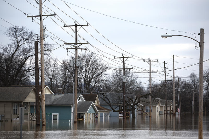 A flooded row of homes is seen just south of the train tracks in downtown Pacific.