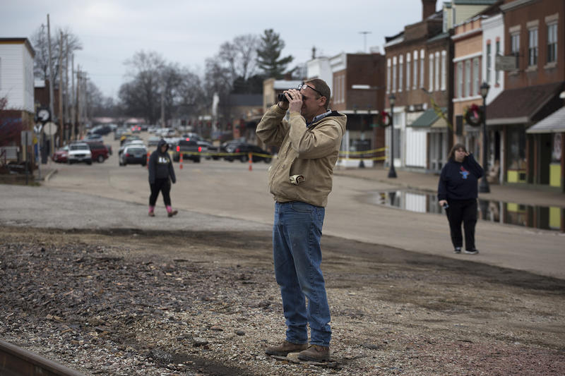 A resident looks toward his flooded duplex, which sits on the southern side of the train tracks in downtown Pacific