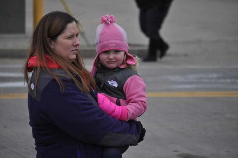 Jodi Howard holds her daughter Brooklyn, 3, as they survey flood damage in Pacific.