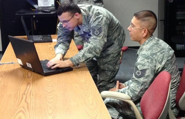 Two airmen take part in cyberspace training at Scott Air Force Base. They are members of two new squadrons at Scott Air Force Base focused on cyber security.