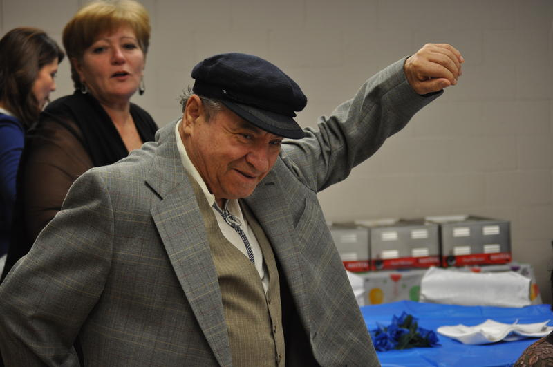 Miron Kofman, a Jewish refugee from Ukraine, strikes a pose during a Hannukah celebration at Bilingual International Assistant Services.