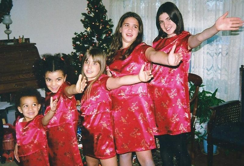 "Emma Clemenson, right, in the late 1990s with four cousins, all in their Christmas kimonas, singing ""Sisters"" from the movie ""White Christmas."" Singing along with the movie has been a family tradition for six decades."