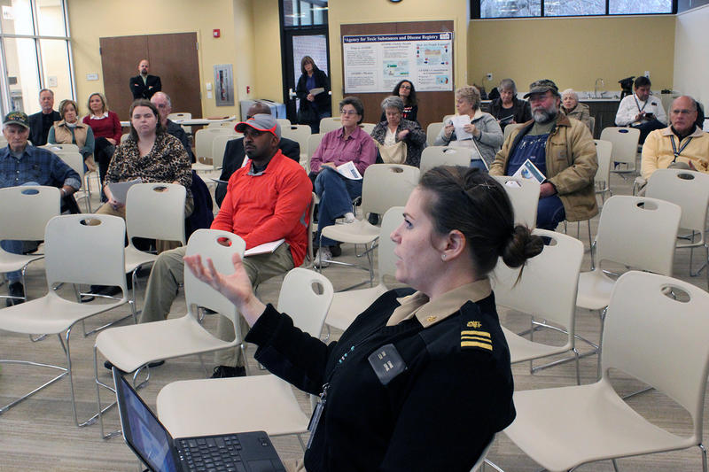 Federal environmental health scientist Erin Evans speaks to area residents at an open house about Coldwater Creek on Wednesday.