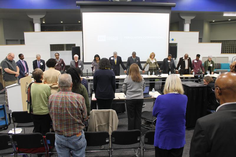 Members of the Ferguson Commission lead a moment of reflection on Monday in St. Louis. The Commission held its final meeting in St. Louis.
