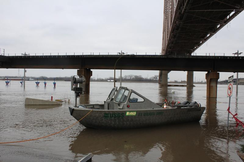 A boat used by the U.S. Geological Survey is moored on Leonor Sullivan Boulevard, which was under water on Dec. 31, 2015.