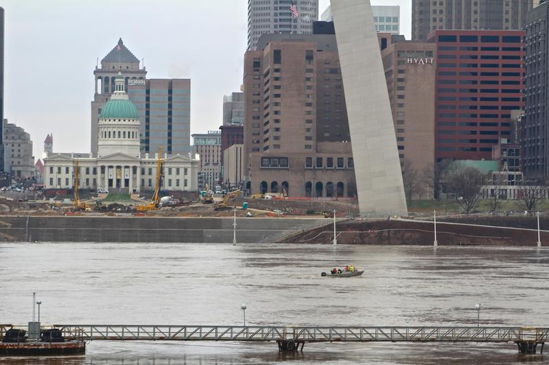 A crew from the U.S. Geological Survey measures the flow of the flooding Mississippi at the Gateway Arch on Dec. 31, 2015.