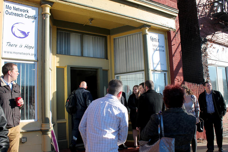 Members and supporters of the Missouri Network for Opiate Reform and Recovery chat outside the network's new outreach center on Fri. Dec. 18, 2015.