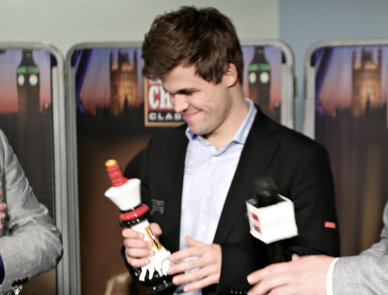 Magnus Carlsen with the London Chess Classic trophy after he won.