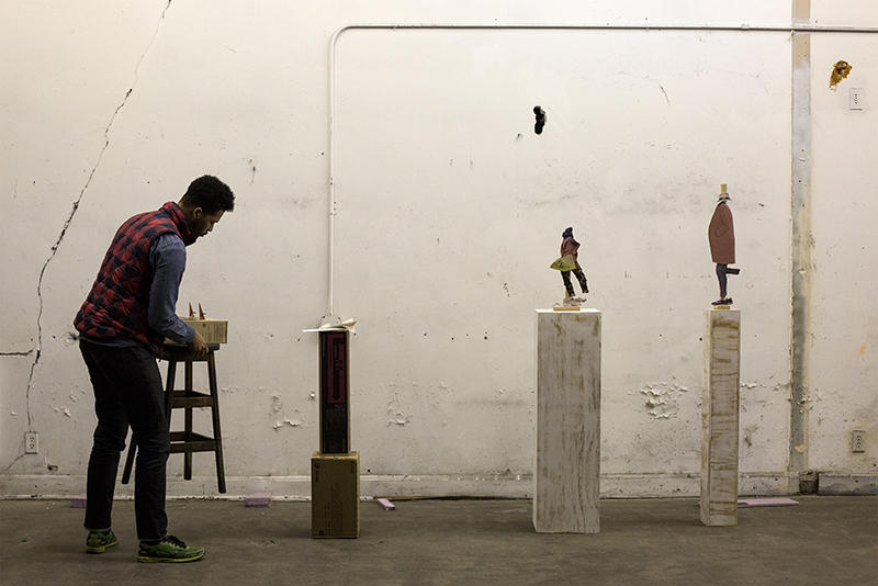Lyndon Barrois Jr. rearranges pieces at his studio in St. Louis on Dec. 9, 2015.