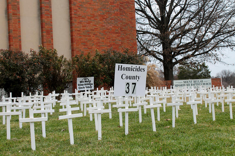 A white cross for every homicide in St. Louis and St. Louis County this year line the lawn of Mount Beulah Missionary Baptist Church Dec. 6, 2015.