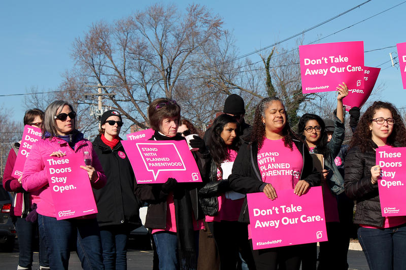 Planned Parenthood supporters rally in 2015 outside the agency's clinic in St. Louis after a mass shooting at a clinic in Colorado Springs.