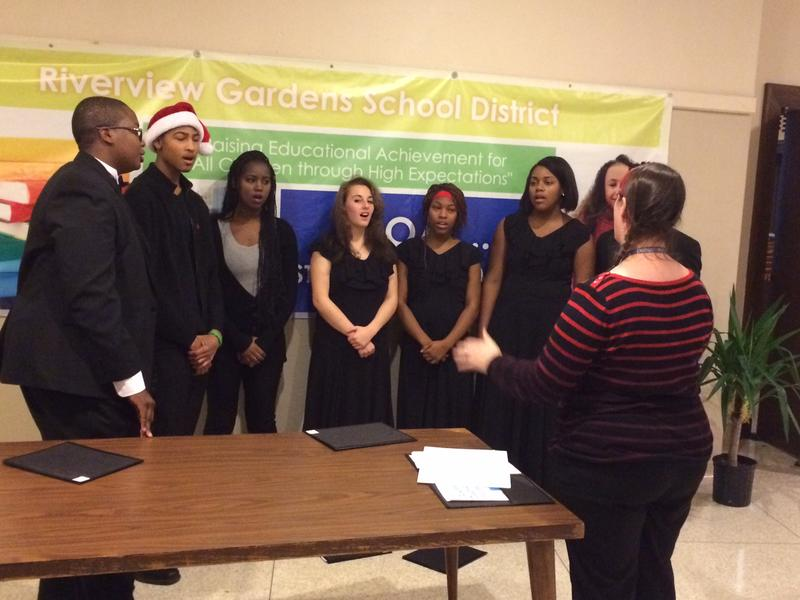 Riverview Gardens students sing before a public hearing on the district in December 2015.