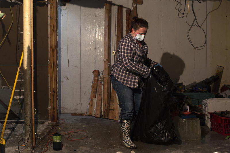 Sandy Evans helps her parents clear out the basement of the house she grew up in on Oak Court in Arnold on Monday afternoon. Floodwater from the Meramec River damaged the basement, which housed a spare bedroom and a bathroom.