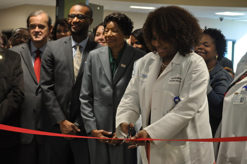 Director Desarie Holmes cuts a ribbon to mark the opening of Behavioral Health Services at Touchette Regional Hospital in Centreville.