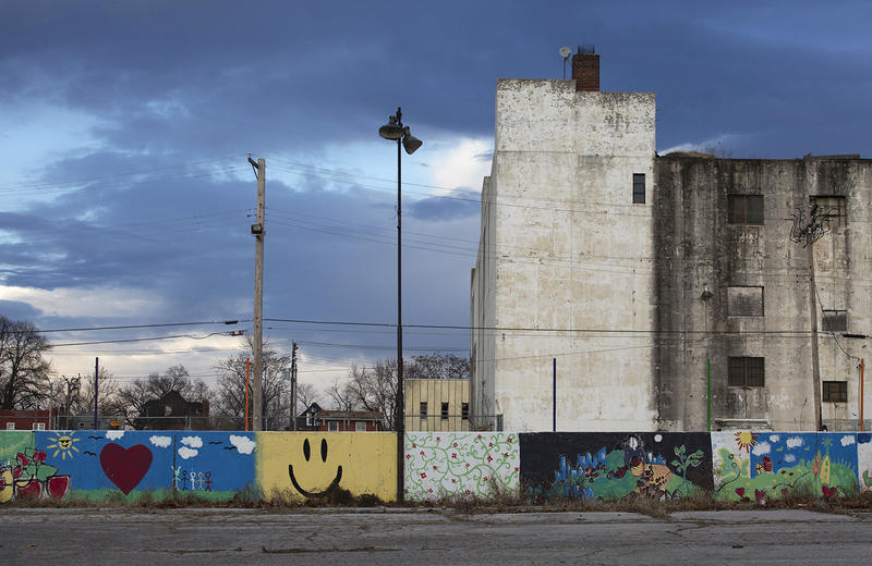A mural sits along a garden wall on Wells Avenue, behind the old J.C. Penney building on Martin Luther King Drive.