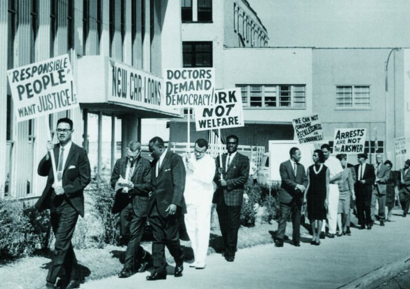 A 1963 photo of the Congress of Racial Equality demonstrating at the Jefferson Bank & Trust Company over the issue of jobs.