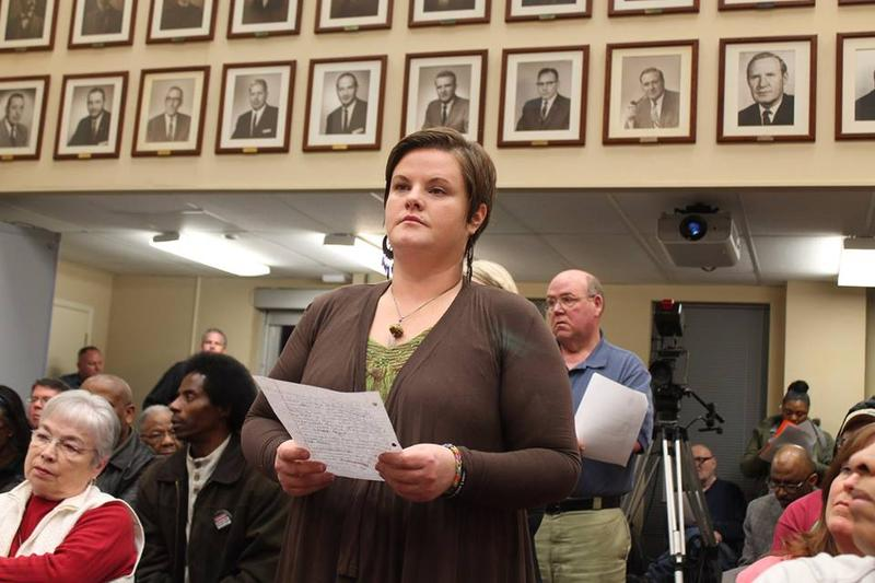 Ferguson resident Emily Davis waits to speak at a 2015 Ferguson City Council meeting. Davis is part of the Ferguson Collaborative, a group that's been following the consent decree process closely.