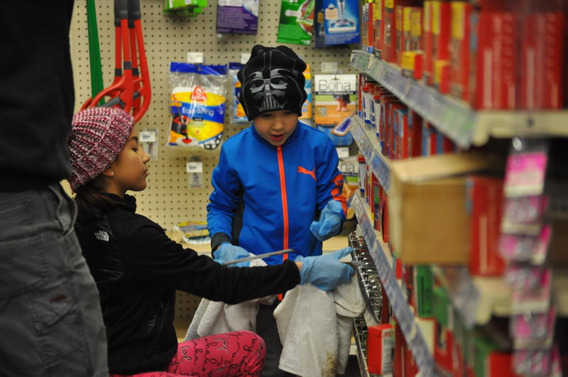 Mia Fernandez, 9, and her brother Mason, 6, help clean up inventory at an ACE Hardware in Eureka with their father, Danny.