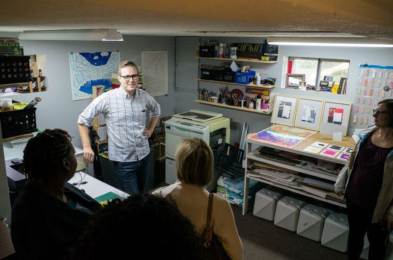 Printmaker Tate Foley welcomes visitors to his home studio during the October 2015 Studio Tours held by the Contemporary Art Museum.
