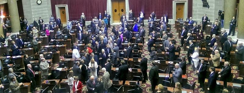Gov. Jay Nixon makes his way to the dais in the Missouri House to deliver his last State of the State address.